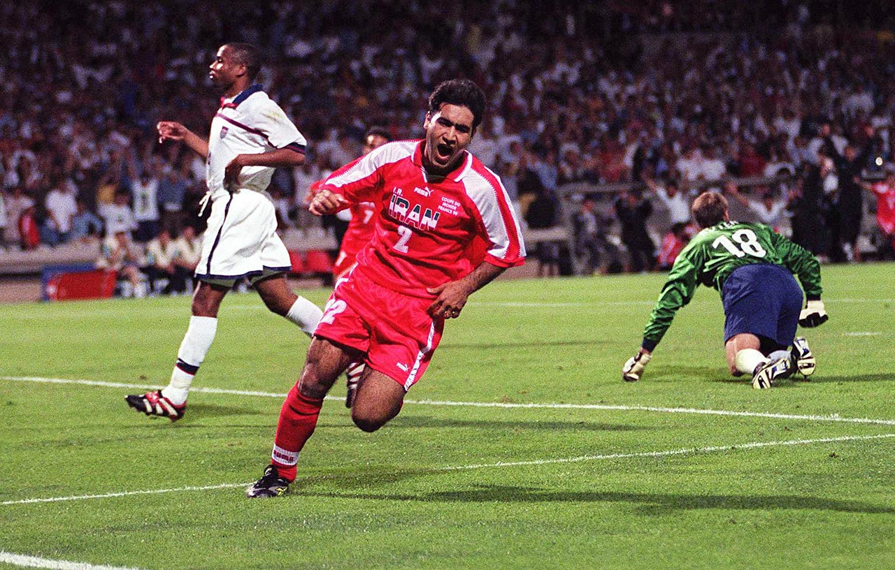 Mehdi Mahdivakia of Iran celebrates his goal against the United States en route to his country's 2-1 victory in the 1998 World Cup.