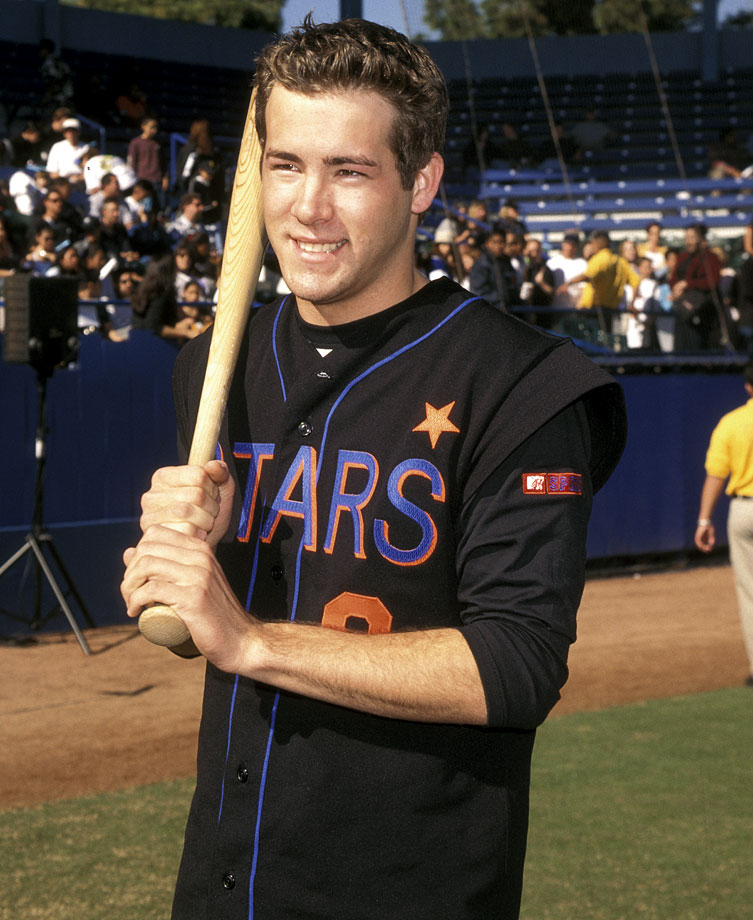 "Ryan Reynolds poses with a bat during MTV""s Rock N' Jock Baseball on Jan. 23, 1999 in Long Beach, Calif."