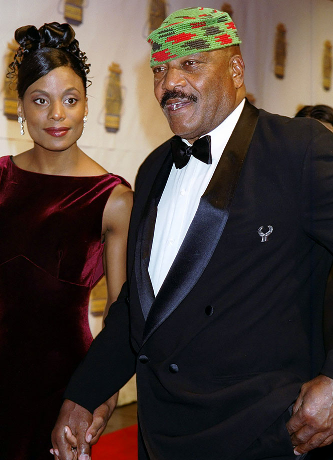 Jim Brown holds hands with his wife, Monique, at Sports Illustrated's 20th Century Sports Awards in 2002. Brown was honored at the New York ceremony as the best football player.
