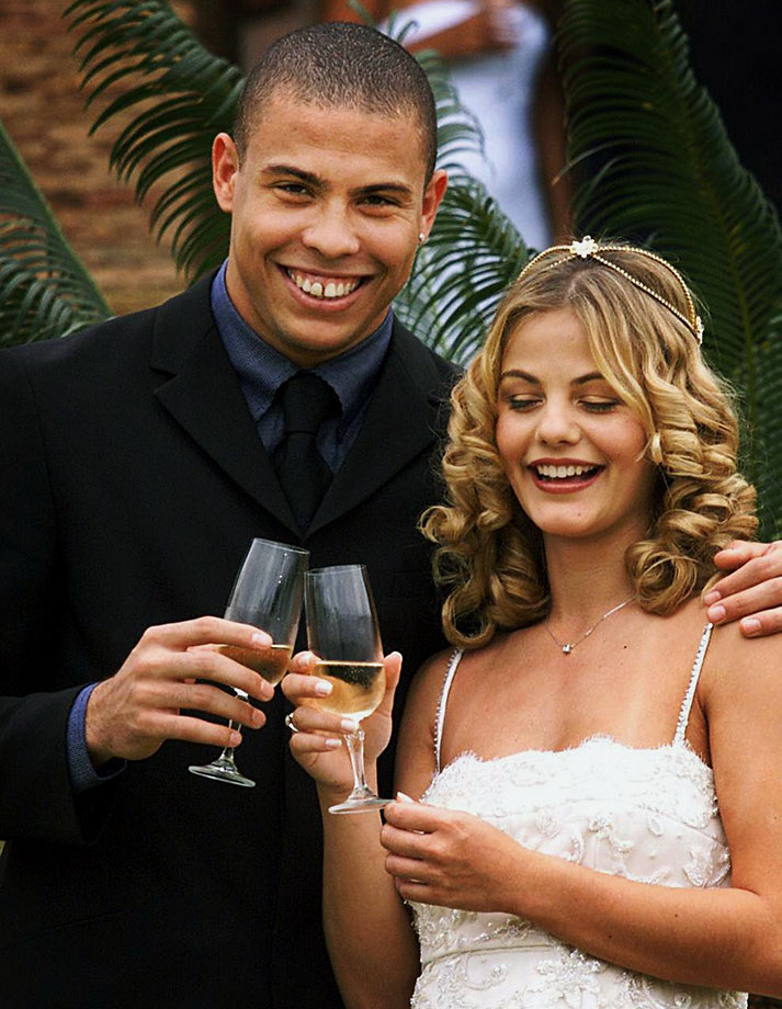 Ronald and his then wife, former Brazilian soccer player Milen Domingues, make a toast during their wedding in 1999.