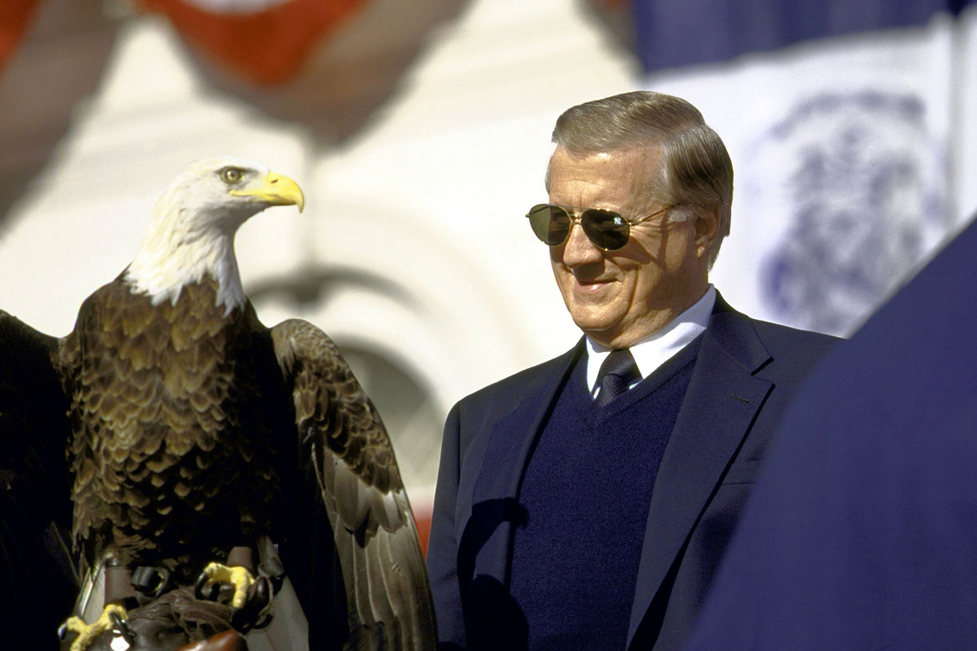 George Steinbrenner admires the bald eagle Challenger during the New York Yankees victory parade on Broadway on Oct. 29, 1999 in New York City.