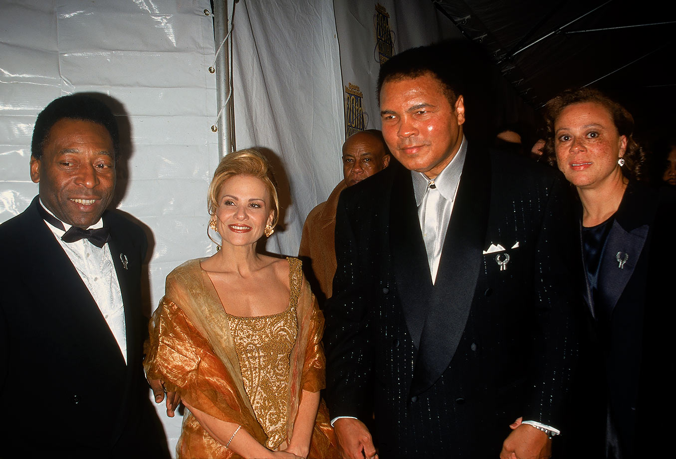 Pelé and his wife, Assiria, pose with boxing legend Muhammad Ali and his wife, Lonnie at Sports Illustrated's 20th Century Sports Awards on Dec. 2, 1989 in New York City. Regarded as the greatest to ever play their respective sports, Ali and Pelé shared something else in common: they both were known by titles other than their birth names. Ali was originally born Cassius Clay, while Pelé is officially named Edison Arantes do Nascimento.