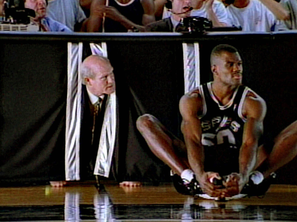 Terry Bradshaw and San Antonio Spurs center David Robinson converse during the filming of a commercial scene for the New York Stock Exchange in 1999.