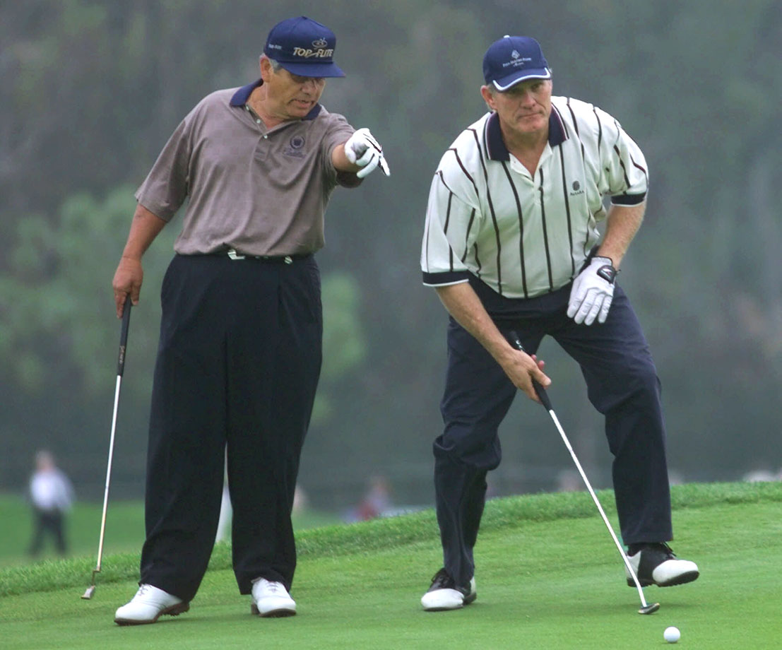Lee Trevino gives advice to Terry Bradshaw during the Sun Microsystems Par 3 Challenge on Nov. 16, 1999, in Carlsbad, Calif