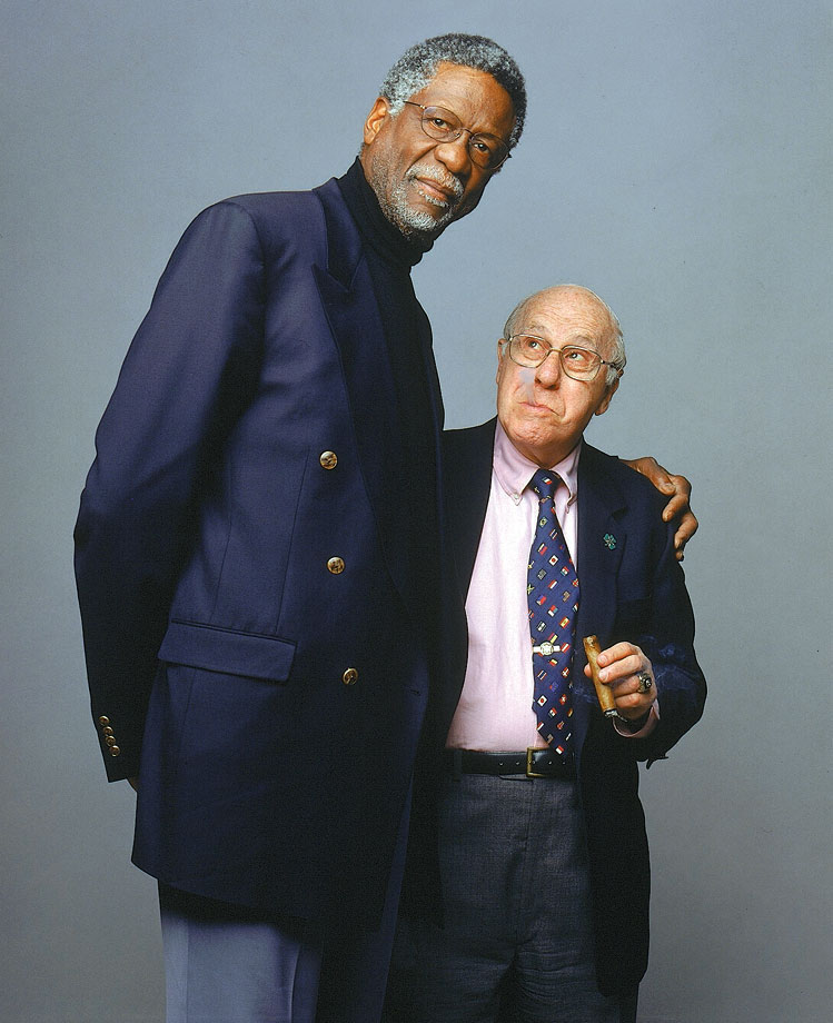 Celtics legends Bill Russell and Red Auerbach pose together for a portrait.