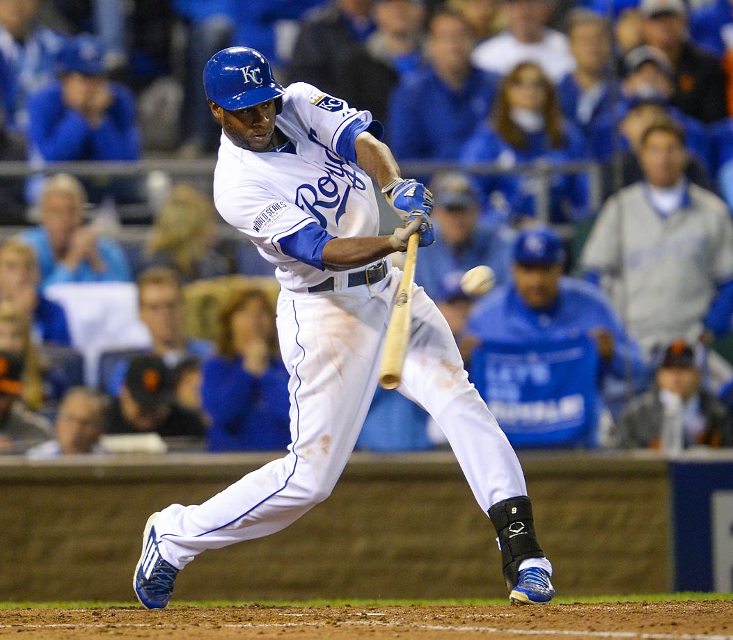 Center fielder Lorenzo Cain hits an RBI ground rule double in the third inning.