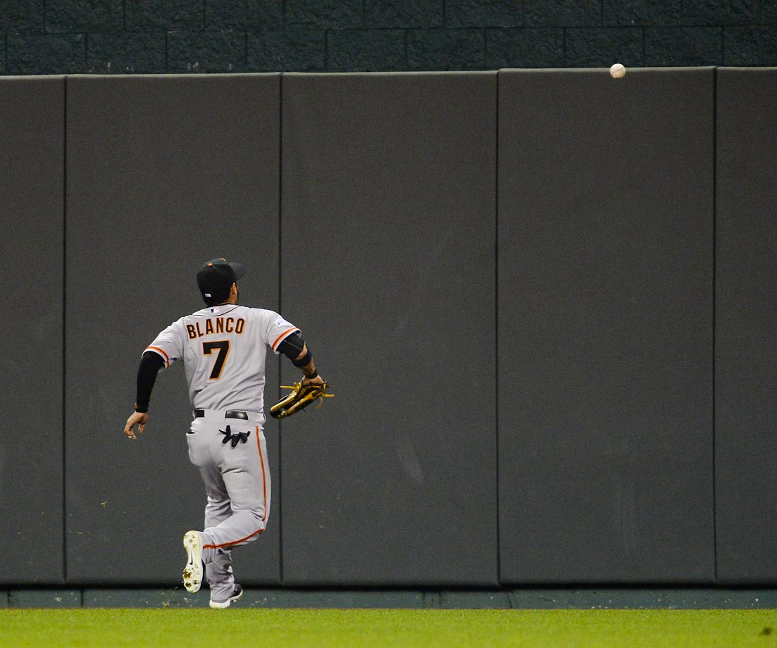 Gregor Blanco chases the ball in center field of Royals' center fielder Lorenzo Cain.