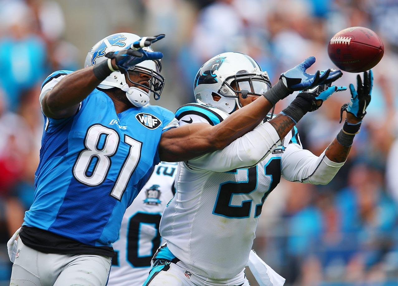 Panthers free safety Thomas DeCoud tries to intercept a pass intended for Lions wide receiver Calvin Johnson.
