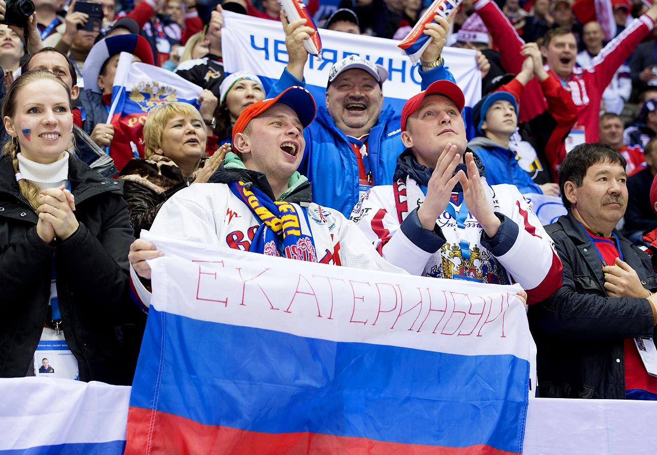 Fans watching Russia play Norway in hockey.