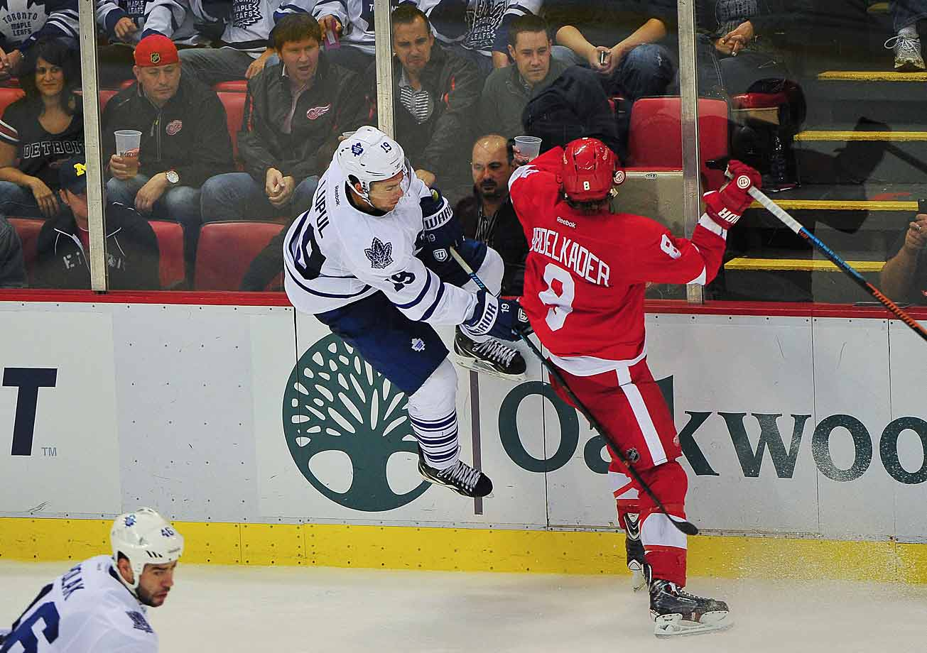 We have lift off: Winger Justin Abdelkader (8) of the Red Wings sent Leafs winger Joffrey Lupul into the boards during their game in Detroit on Oct. 18.