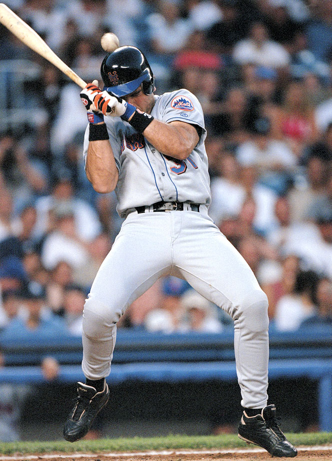 Mike Piazza takes a pitch off the helmet from Yankees pitcher Roger Clemens in July 2000.