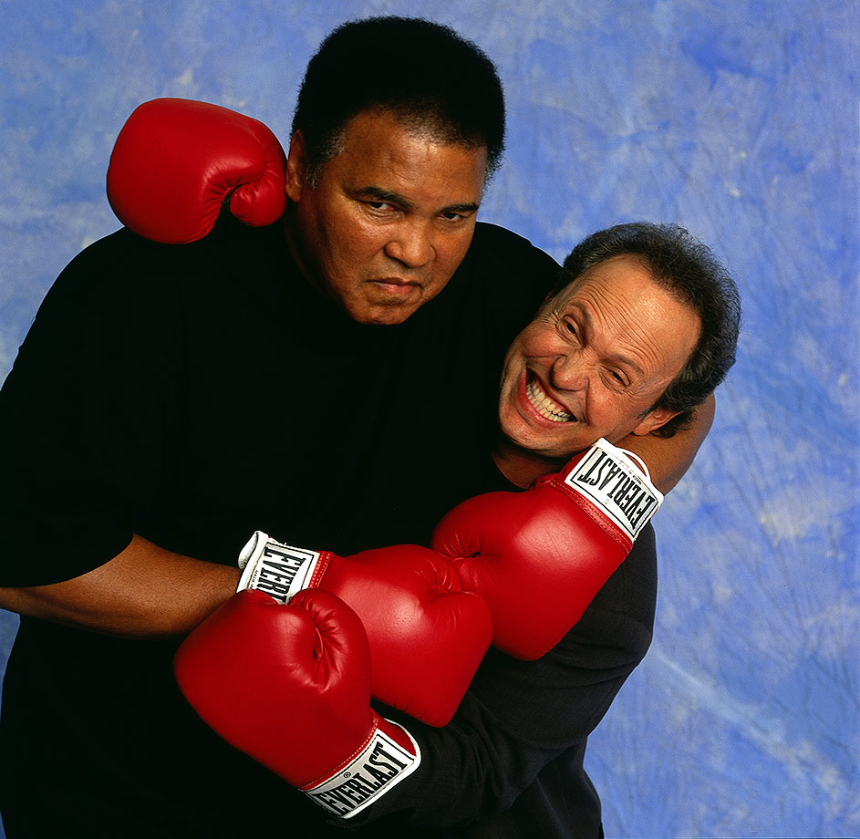 Ali messes around with actor Billy Crystal during a photo shoot in 2000. Crystal's impression of Ali was notorious, and he performed at a tribute to the boxer on his 50th birthday in December 1991.