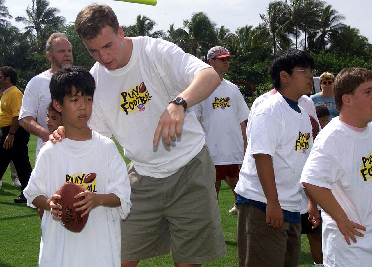 Peyton Manning gives passing instructions during a Pro Bowl Special Olympics Event. Manning has been named to 13 Pro Bowls during his career.
