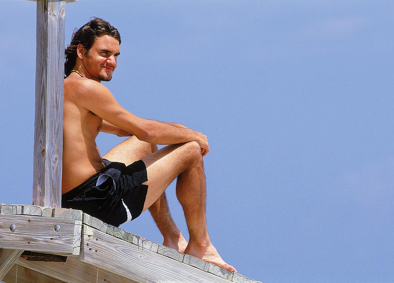 Roger Federer relaxes on the beach for a feature shoot during the Ericsson Open in Key Biscayne, Fla., on March 27, 2000.