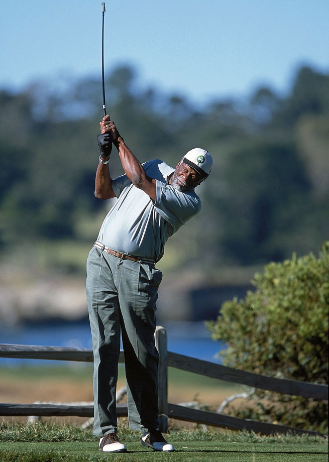 Bill Russell shows off his golf stroke at the Pebble Beach Pro-Am.