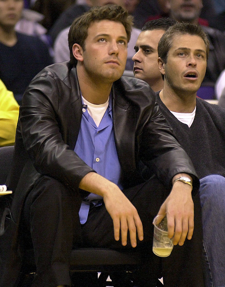 Ben Affleck looks up at the scoreboard during the Los Angeles Lakers game against the Washington Wizards on March 23, 2001 at Staples Center in Los Angeles.
