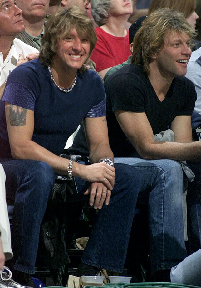 Richie Sambora and Jon Bon Jovi watch the Dallas Mavericks game against the Utah Jazz at Reunion Arena in Dallas.