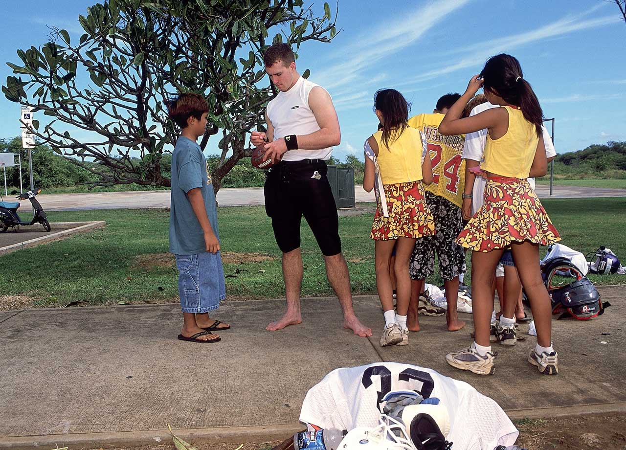 Always a fan favorite, Drew Brees signs autographs before the Hula Bowl in Hawaii. He'd throw for 119 yards and a touchdown in the game.