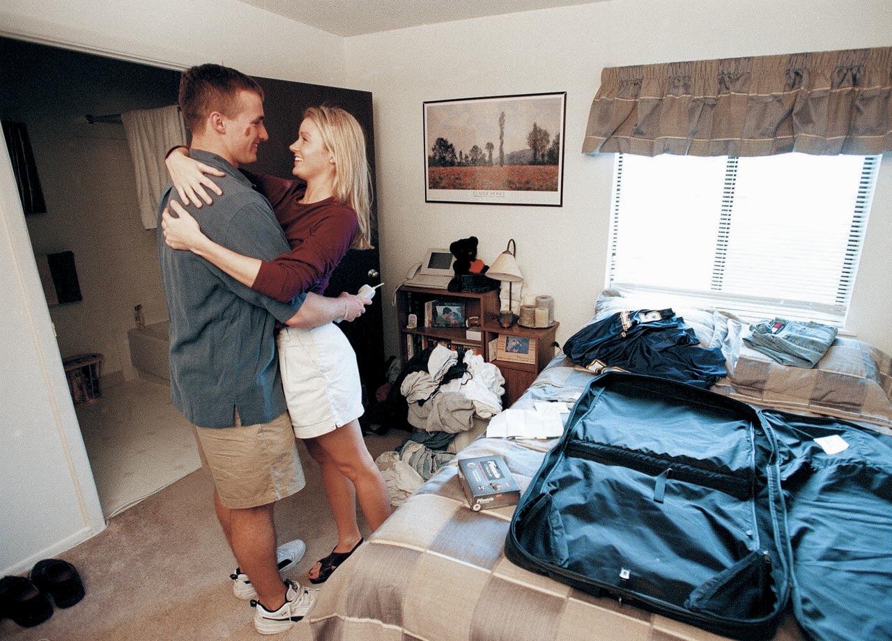 Locked in a quick embrace, Drew Brees hugs then-girlfriend Brittany as they pack their bags after Brees was selected by the Chargers in the NFL draft. She'd stick around longer than San Diego would. Drew and his college sweetheart have been happily married since 2003, though he parted ways with the Chargers after the 2005 season.