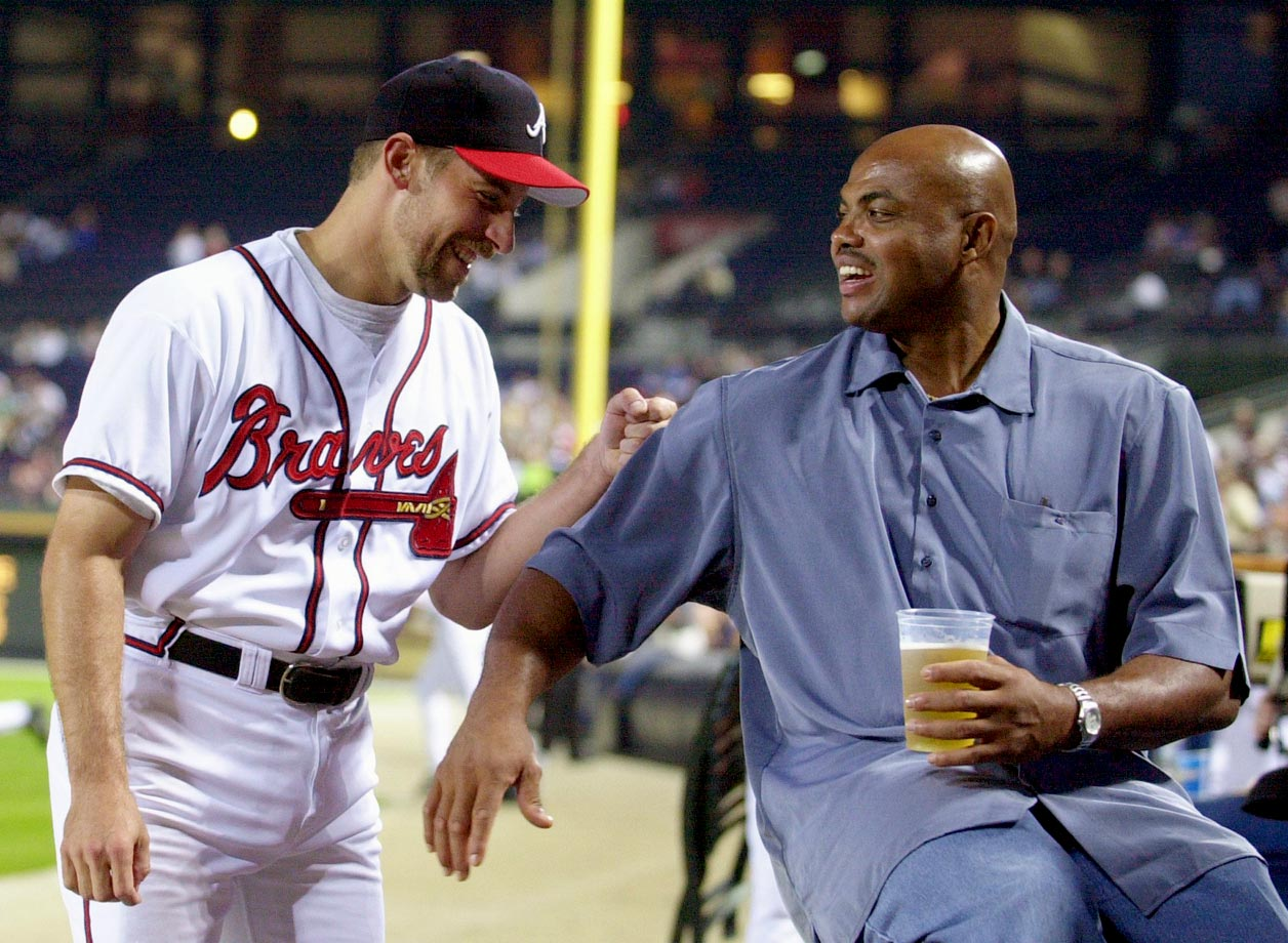 Atlanta Braves closer John Smoltz enjoys a laugh with Charles Barkley before a game against the Philadelphia Phillies in Atlanta.
