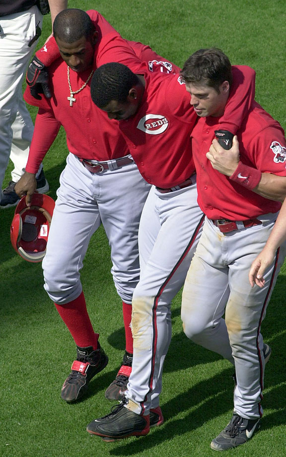 After playing 145 games in his debut season in Cincinnati in 2000, Ken Griffey Jr. was felled by a string of injuries to his hamstrings, knees, ankles and shoulder. Over the next six seasons, he made eight appearances on the disabled list and never played more than 128 games in a season.  Here, Griffey is helped off the field by teammates Deion Sanders and Jaosn LaRue after injuring his left hamstring on March 26, 2001.