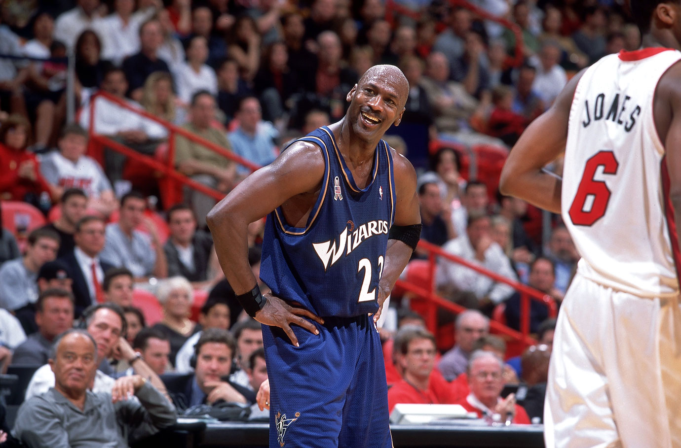 Michael Jordan flashes a smile during a Washington Wizards game against the Miami Heat in November 2001.