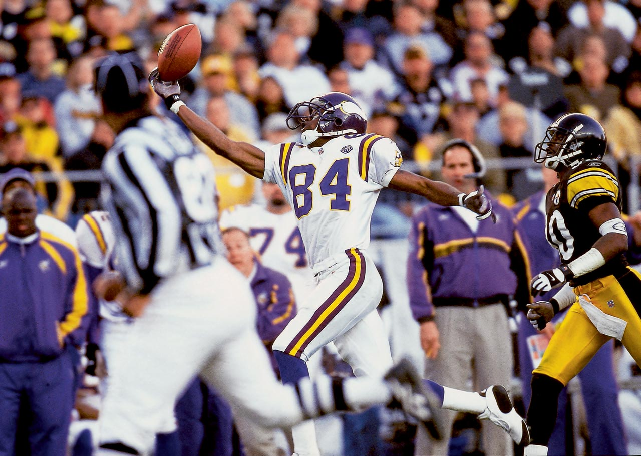 Vikings wideout Randy Moss took matters into his own hand to make this reception against the Steelers.