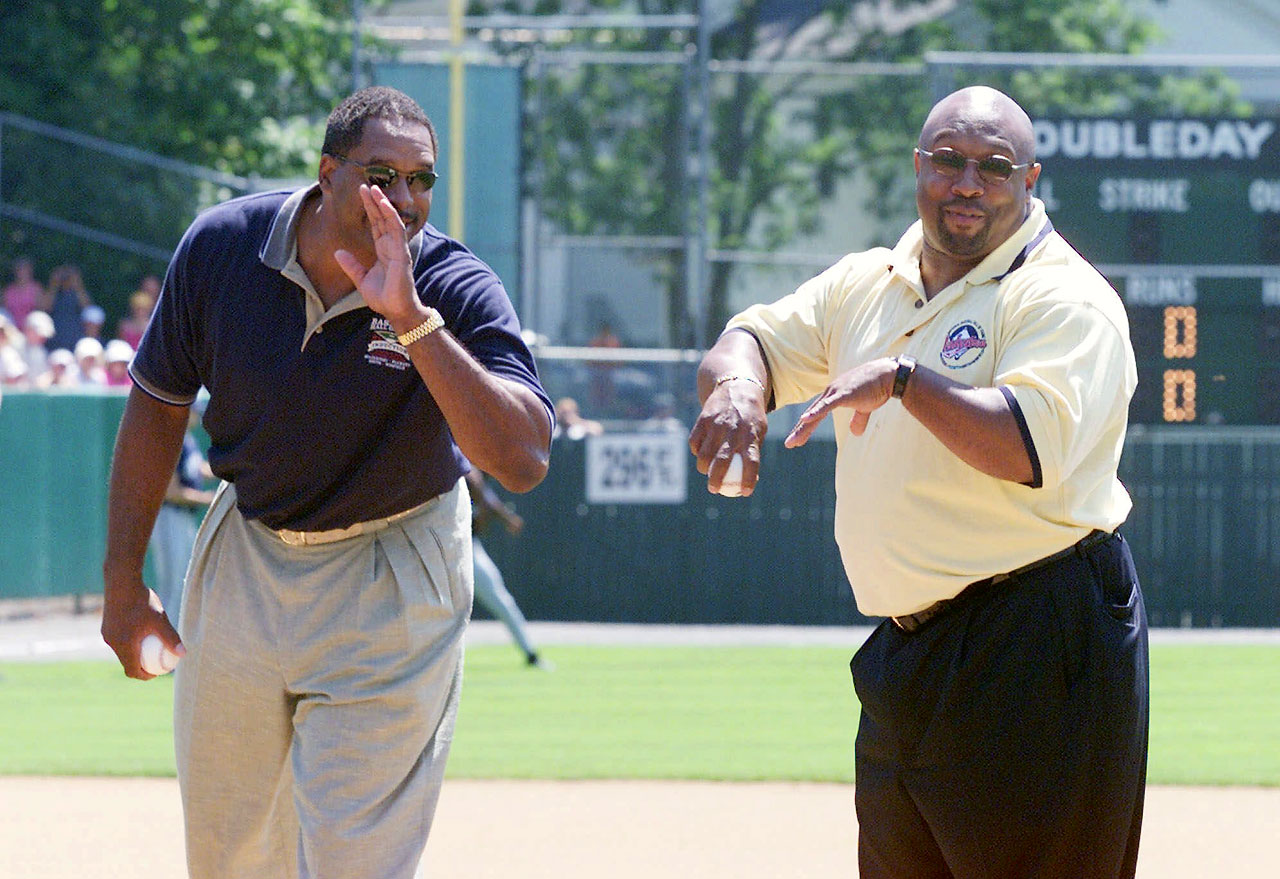 Newly inducted members of the Baseball Hall of Fame Dave Winfield and Kirby Puckett, prepare to toss out the ceremonial first pitch before the 55th annual Hall of Fame Game in Cooperstown, NY.