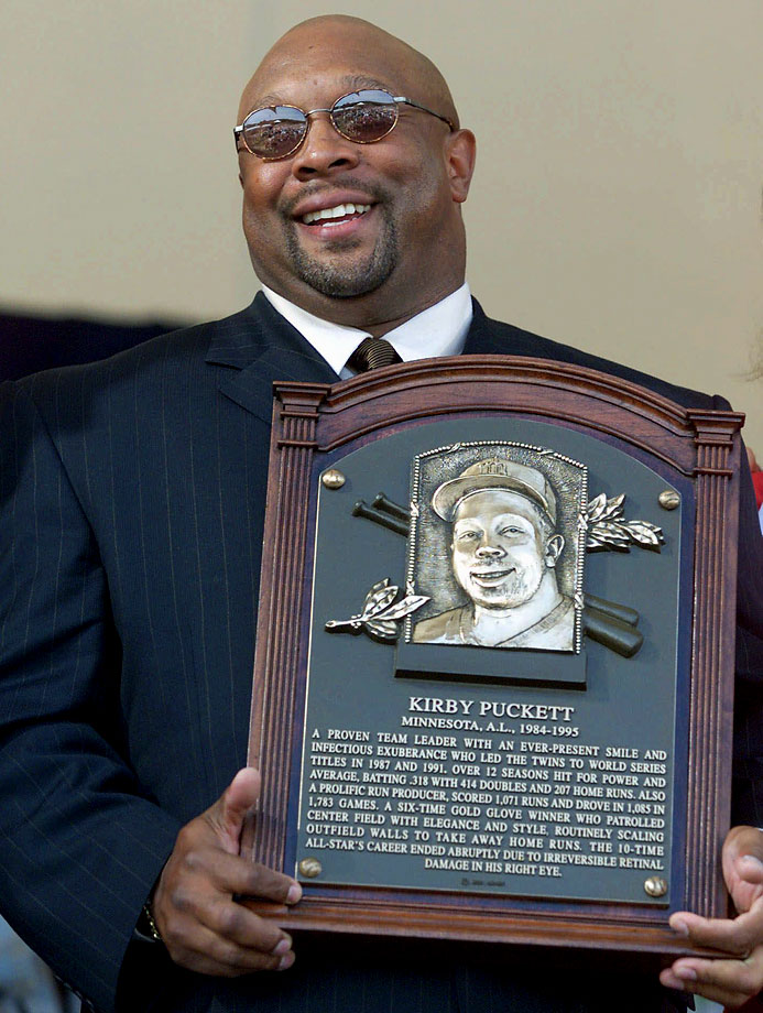 Kirby Puckett dispalys his plaque during the National Baseball Hall of Fame induction ceremonies in Cooperstown, NY.