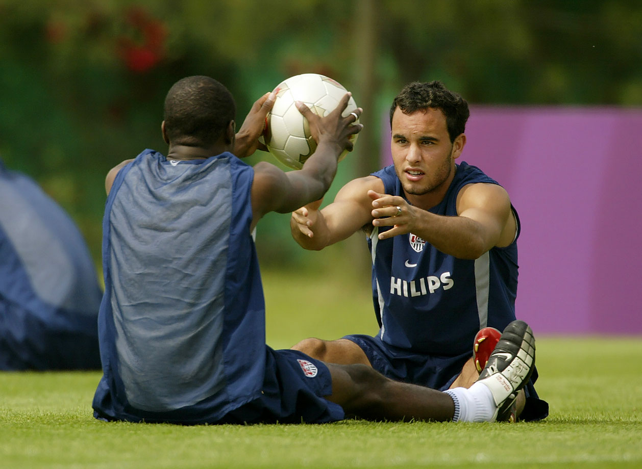 Landon Donovan and DaMarcus Beasley pass the ball in a stretching drill at the Misari Football Center in Seoul, Korea.