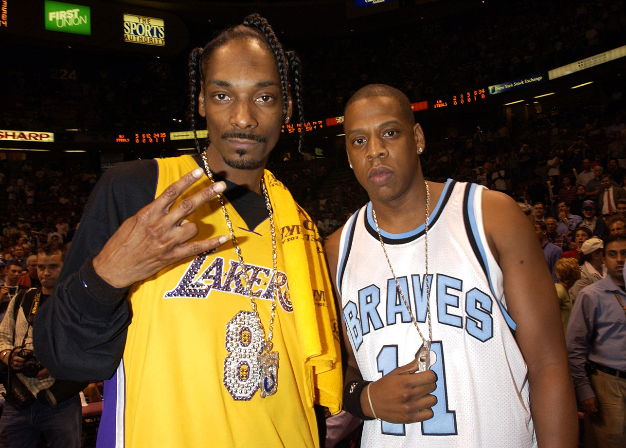 Snoop Dogg and Jay-Z pose together during Game Four of the NBA Finals between the Los Angeles Lakers and New Jersey Nets on June 12, 2002 at Continental Airlines Arena in East Rutherford, N.J.