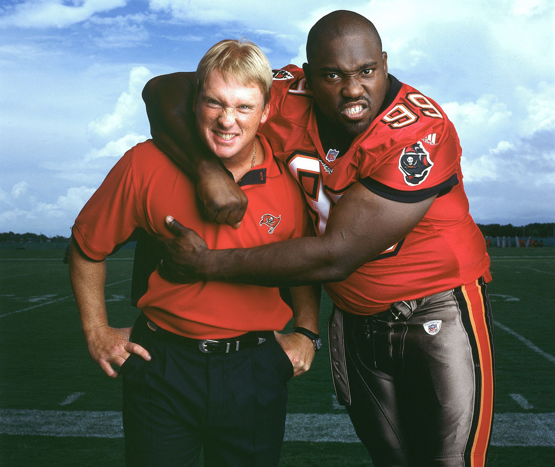 Bucs head coach Jon Gruden poses with his defensive end Warren Sapp on Aug. 28, 2002 in Tampa, Fla.