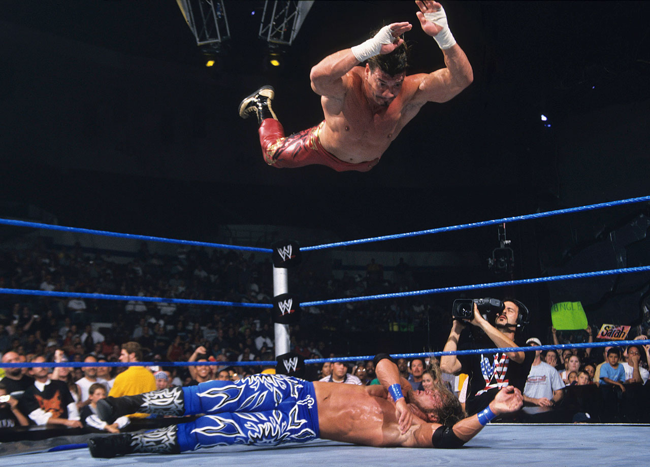 Edge and Eddie Guerrero go all-out in a brutal match, using ladders to batter each other, with Edge the victor.