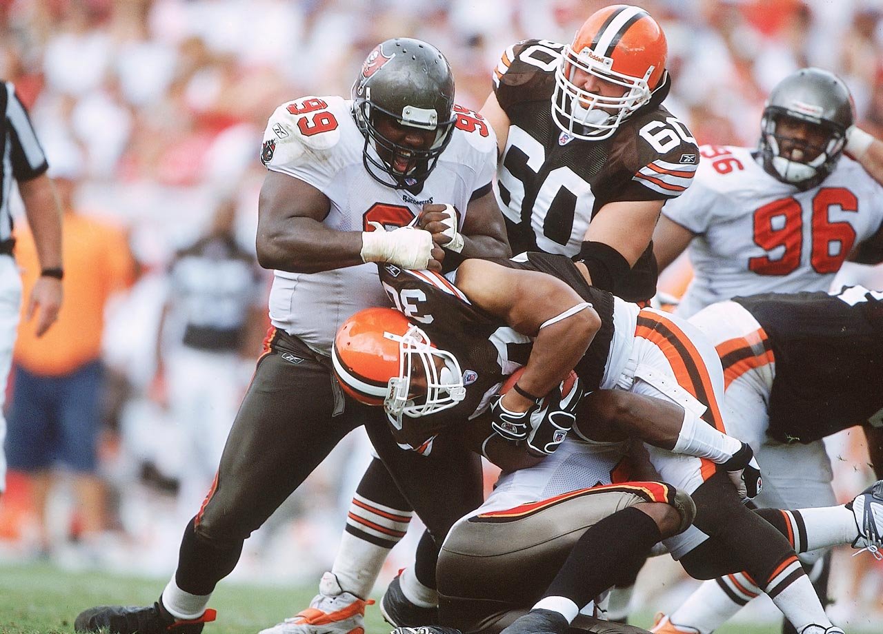 Warren Sapp helps tackle Jamel White during the Tampa Bay Buccaneers game against the Cleveland Browns on Oct. 13, 2002 in Tampa, Fla. The Bucs won the game, 17-3.