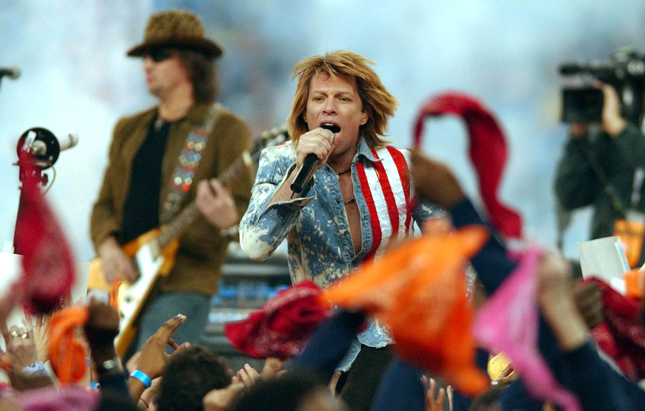 Bon Jovi performs as part of the halftime show during the Thanksgiving Day game between New England Patriots and Detroit Lions at Ford Field.