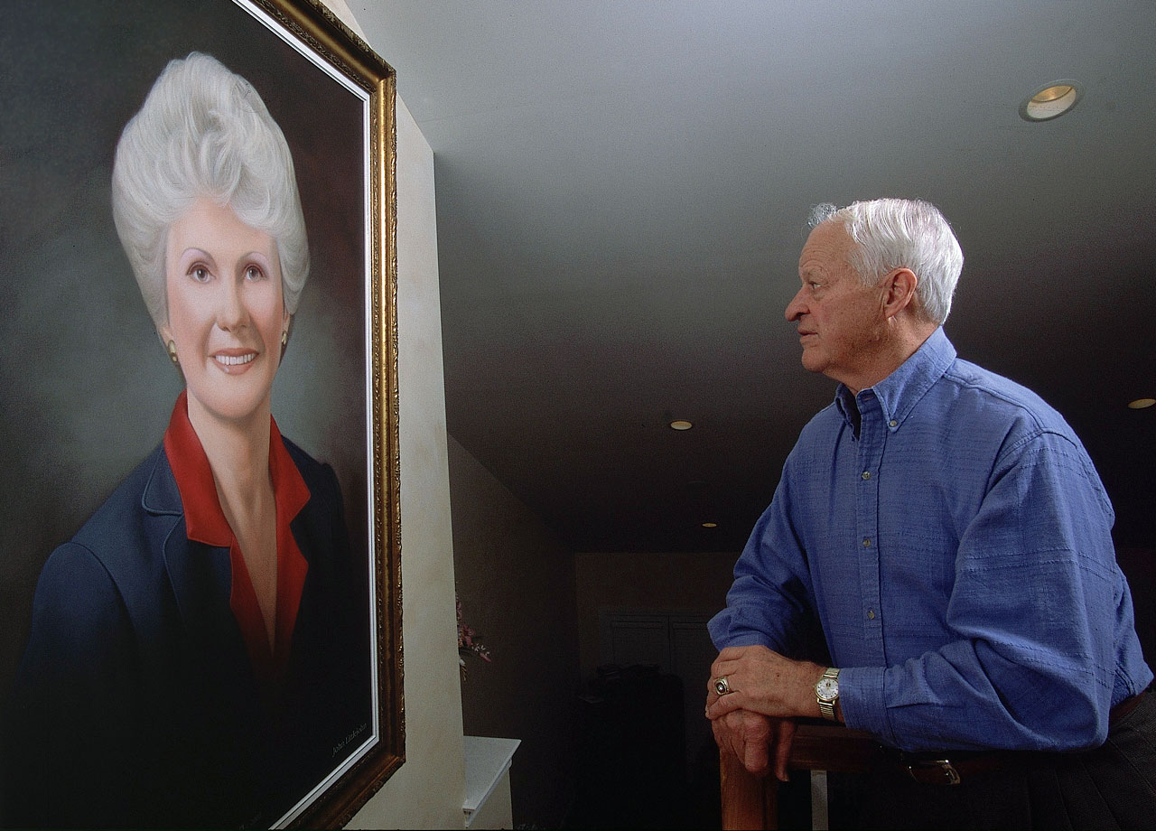 Gordie Howe admires a portrait of his wife Colleen, a sports agent who founded Power Play International and Power Play Publications to manage the business interests of her husband.  The two were married for nearly 56 years, before her passing in 2009.