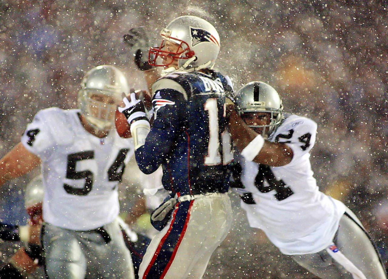 "Tom Brady was hit from behind by cornerback Charles Woodson and fumbled the ball, which would have sealed the win for the Raiders. Instead, a video review overturned the call on the basis of the ""Tuck Rule."" The Patriots went on to win the AFC divisional playoff game 16-13 and their first Super Bowl.  11 years later, the NFL abolished the rule."