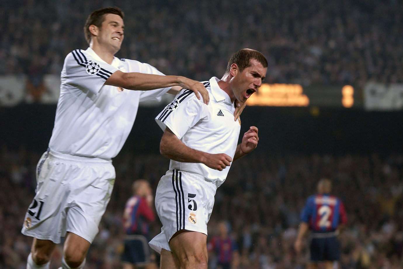 Real Madrid wins the first leg of their Champions League semifinal 2-0. Zinedine Zidane and Steve McManaman score in Barcelona en route to Madrid's 3-1 aggregate win. Madrid went on to win the Champions League.