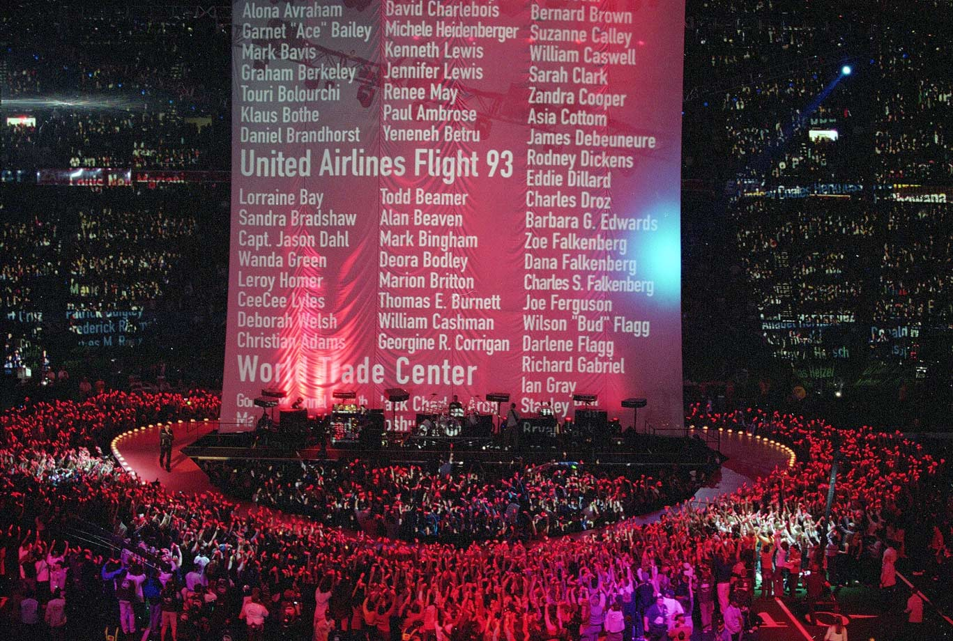 "Months after the Sept. 11 terrorist attacks, U2 delivered a moving tribute to America and the victims of 9/11. The Irish rockers opened with ""Beautiful Day,"" followed by the subdued ""MLK"" and a powerful rendition of ""Where the Streets Have No Name."" As the Edge played the hypnotic guitar part, the victims' names scrolled to the heavens on a towering backdrop. At the end, when Bono opened his jacket to reveal a stars-and-stripes lining, the whole stadium erupted."