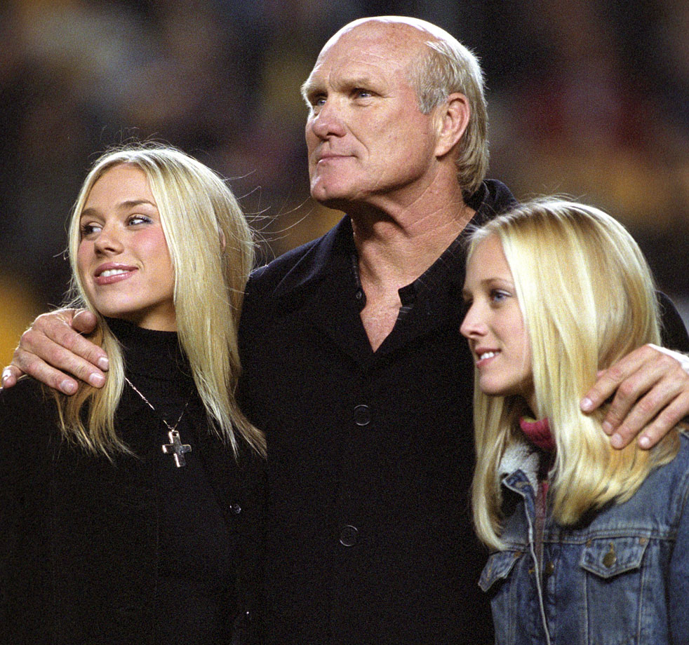 Terry Bradshaw poses proudly with his daughters before an October 2002 game against the Indianapolis Colts at Heinz Field in Pittsburgh.