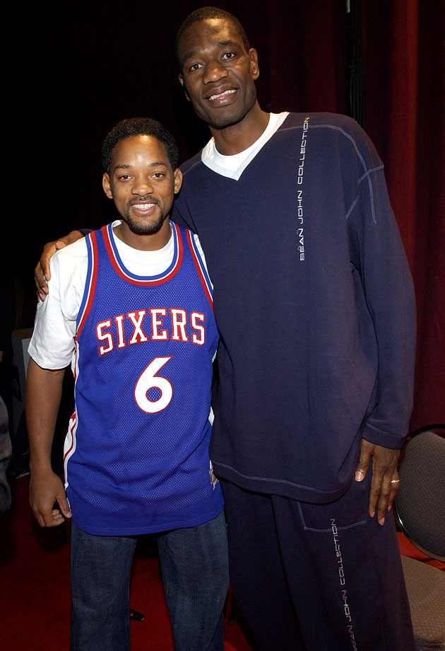 Will Smith poses with Dikembe Mutombo backstage at the NBA All-Star Read to Achieve Celebration in Philadelphia.
