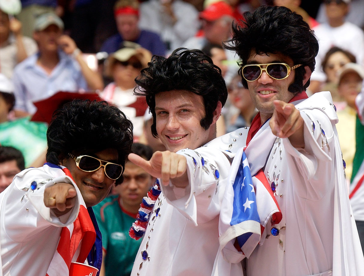 USA and Elvis fans strike a pose prior to the USA-Mexico World Cup match in Jeonju, South Korea on June 17, 2002.