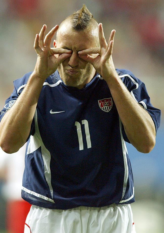 American Clint Mathis gestures to the linesman to open his eyes during the U.S. vs. Poland Group D match in the 2002 World Cup.
