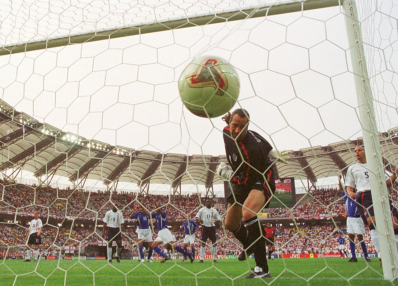English goalkeeper David Seaman looks on in dismay after Brazil's Ronaldinho scores a phenomenal 42-yard free kick goal off the top left corner of the goal in the second half of a 2002 World Cup quarterfinal.