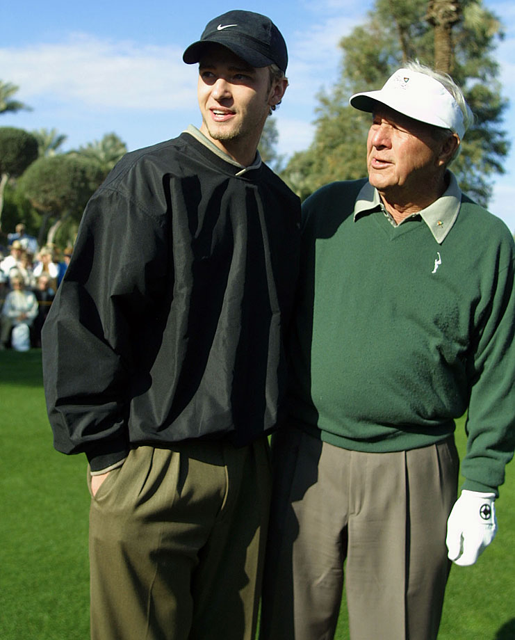 Justin Timberlake chats with Arnold Palmer on the 10th tee during the opening round of the Bob Hope Chrysler Classic at Indian Wells Country Club in La Quinta, Calif., on Jan. 16, 2002.