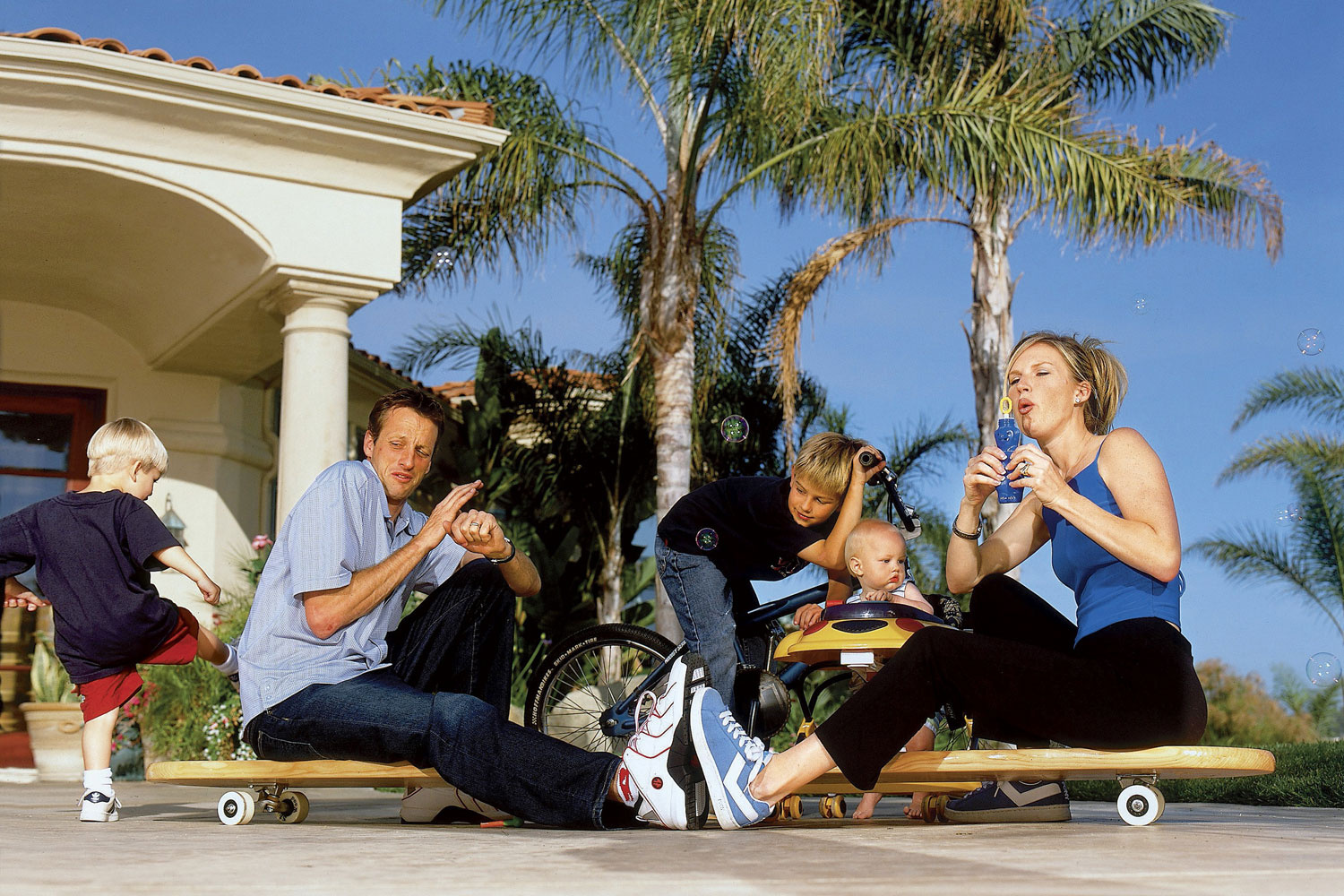 Tony Hawk poses for Sports Illustrated back in 2002 with his family at their home in Carlsbad, CA.