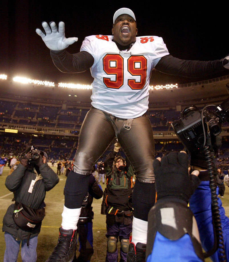 Warren Sapp celebrates after the Tampa Bay Buccaneers won the NFC Championship game, 27-10, against the Philadelphia Eagles on Jan. 19, 2003 in Philadelphia.