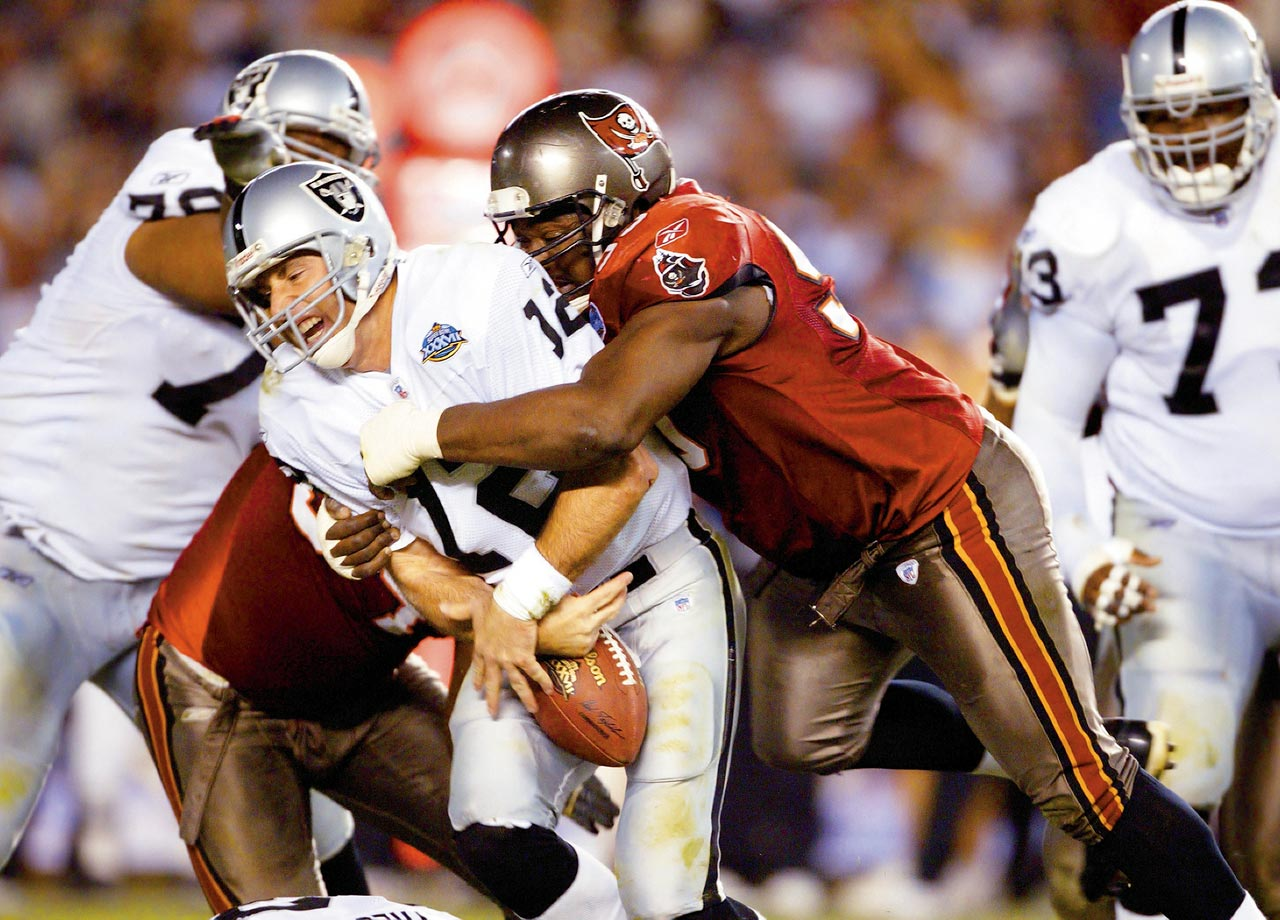 Warren Sapp sacks Rich Gannon, forcing a fumble during Super Bowl XXXVII between the Tampa Bay Buccaneers and Oakland Raiders on Jan. 26, 2003 in San Diego. The Bucs won the game, 48-21.
