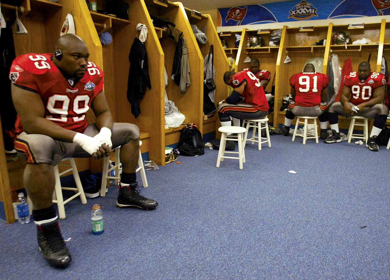 Warren Sapp listens to music in the locker room before Super Bowl XXXVII between the Tampa Bay Buccaneers and Oakland Raiders on Jan. 26, 2003 in San Diego.