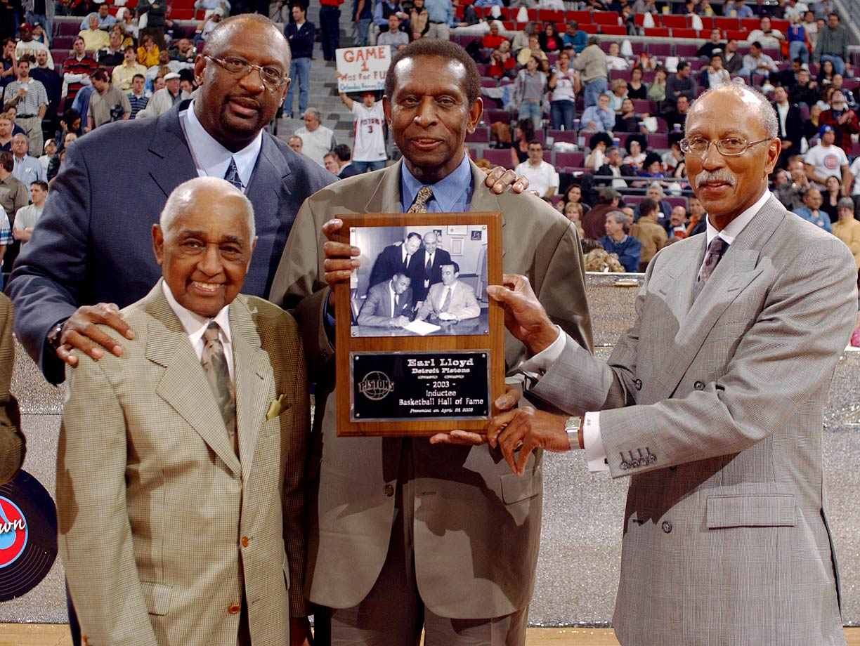 Bob Lanier, Will Robinson, Earl Lloyd and Dave Bing pose for a picture at halftime of Game 2 of the Pistons-Magic first round series during the 2003 NBA Playoffs in Auburn Hills, Mich.